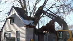 House being torn down in neighborhood - stock footage