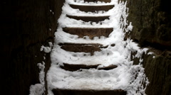 Hiker walking up Snow on Steps Stock Footage