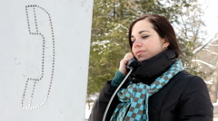 Girl at Phonebooth with scarf on Stock Footage