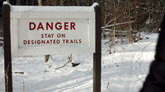 Stay on trail sign on winter path Stock Footage