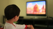 Stock Video Footage of little boy watching tv 2
