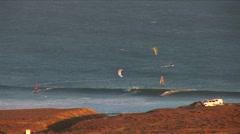 Kitesurf-on wave distance shot Stock Footage