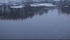 Movement of ice floes on river. Snowy European winter. - stock footage