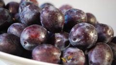 Fresh Picked Plums Turning Stock Footage