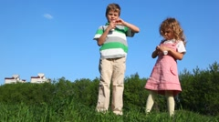 Kids openning bottles with yoghurt and drink Stock Footage