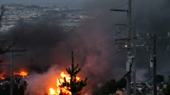 Helicopter dumps water on San Bruno fire, caused by gas explosion,September 2010 Stock Footage