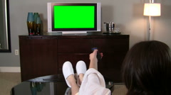 Woman watches green screened TV - HD - stock footage