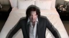 Businessman falls backwards on bed V3 - HD - stock footage