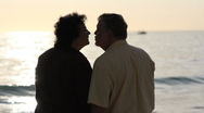 Stock Video Footage of Husband and wife kiss at sunset