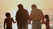 Stock Video Footage of Family watching sunset at beach