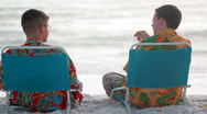 Stock Video Footage of Brothers talking on the beach
