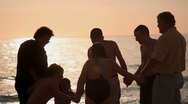 Stock Video Footage of Family playing in the sunset at beach