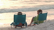 Stock Video Footage of Young children relaxing at the beach