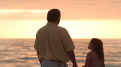Dad and daugher talking on the beach Stock Footage