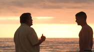Stock Video Footage of Dad takes time to talk to son at beach