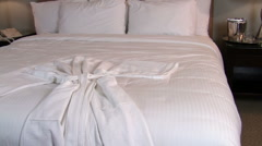 White bathrobe on bed dolly - HD Stock Footage