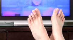 Watching TV feet up V6 - HD Stock Footage
