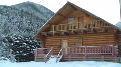 Winter Log Cabin, western Canada Stock Footage