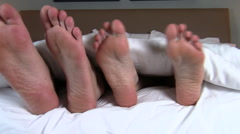 Male and female feet in bed V2 - HD - stock footage