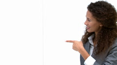 Busineswoman pointing at a white board Stock Footage