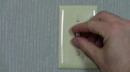 Light switch turning on off - HD Stock Footage