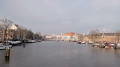 Cruiseboat cruising on the river Amstel in Amsterdam Netherlands Stock Footage