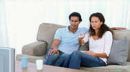 Couple being scared by a movie on the television Stock Footage