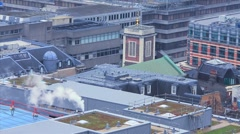 Buildings Roof with Chimney Smoke Stock Footage