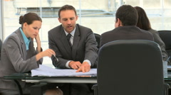 Business people working together on a document - stock footage