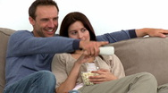Happy couple watching television Stock Footage