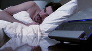 Stock Video Footage of Alarm clock wakes up man V1 - HD