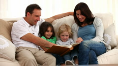 Cute family reading a book Stock Footage