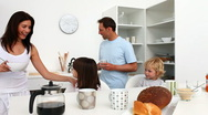 Family taking breakfast together Stock Footage
