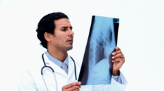 Surgeon looking at an x ray Stock Footage