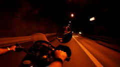 Biker tunnel road travel speed Stock Footage