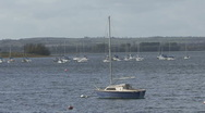 Stock Video Footage of Yacht moored to buoy turns on wind on Rutland Water.