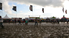 glastonbury festival mud music event crowd - stock footage