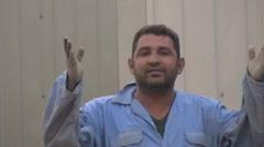 Iraqi worker blows a kiss Stock Footage