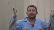 Stock Video Footage of Iraqi worker blows a kiss