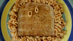 Spaghetti letters on toast lunch Stock Footage