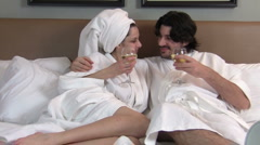 Couple drinks wine in bed V2 - HD - stock footage