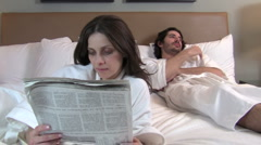 Woman reads paper ignores man - HD Stock Footage