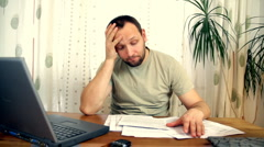 Man stressed because of bills Stock Footage