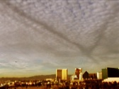 Stock Video Footage of Las Vegas-wide and plane with chemtrails