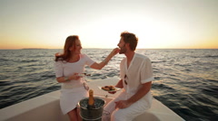 Young couple on a sunset boat trip Stock Footage