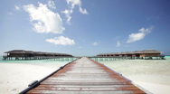 Stock Video Footage of wooden walking path to overwater bungalows