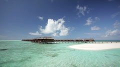 Overwater bungalows on a tropical island Stock Footage