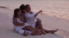 Young family of three happy together on a beach Stock Footage