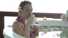 Woman drinking tea in tropical spa Stock Footage