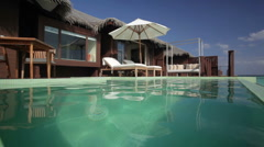 Pool in front of overwater bungalow Stock Footage